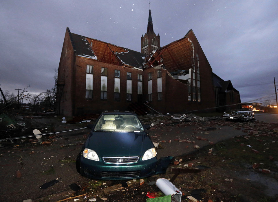 Photo - Early Monday morning sunlight shows the destruction Sunday's tornado caused in this Hattiesburg, Miss., neighborhood adjacent to the University of Southern Mississippi, including the severe damage to Westminster Presbyterian Church Feb. 11, 2013. Emergency officials said late Sunday that at least 10 people were injured in surrounding Forrest County and three were hurt to the west in Marion County, but they weren't aware of any deaths caused by the storms. (AP Photo/Rogelio V. Solis)