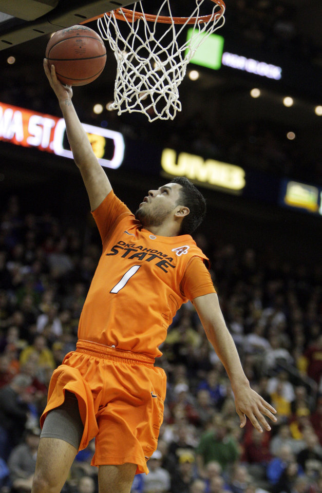 Oklahoma's Cezar Guerrero (1) shoots a lay up during the Big 12 tournament men's basketball game between the Oklahoma State Cowboys and Missouri Tigers the Sprint Center, Thursday, March 8, 2012.  Photo by Sarah Phipps, The Oklahoman