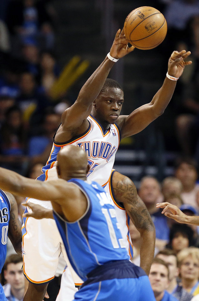 Photo - Oklahoma City's Reggie Jackson (15) passes during an NBA basketball game between the Oklahoma City Thunder and the Dallas Mavericks at Chesapeake Energy Arena in Oklahoma City, Monday, Feb. 4, 2013. The Thunder won. 112-91. Photo by Nate Billings, The Oklahoman