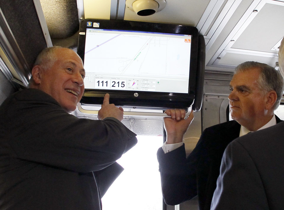 Photo -   Illinois Gov. Pat Quinn, left, points out the speed of the Amtrak train that he and US Transportation Secretary Ray LaHood are riding as it reaches 111 mph on a test run between Dwight and Pontiac, Ill., Friday, Oct. 19, 2012, in Pontiac, Ill. (AP Photo/Charles Rex Arbogast)