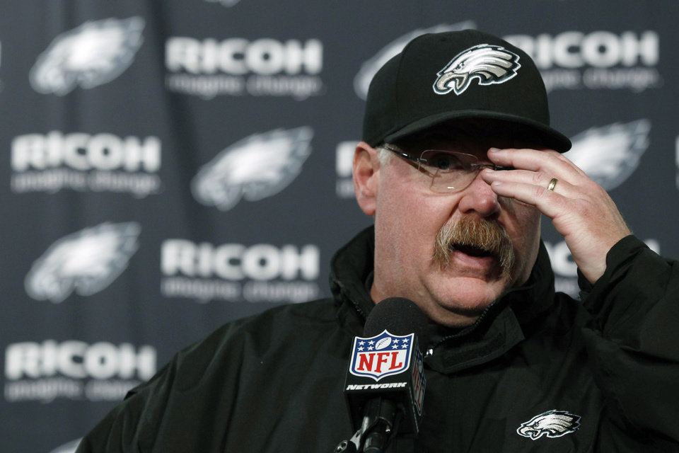 Philadelphia Eagles coach Andy Reid gestures during a news conference after the Eagles\' NFL football game against the Washington Redskins, Sunday, Dec. 23, 2012, in Philadelphia. Washington won 27-20. (AP Photo/Michael Perez)