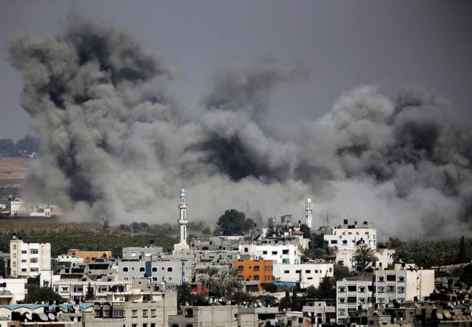 Photo - Smoke rises after an Israeli strike hit Gaza City, northern Gaza Strip, Thursday, July 31, 2014.  Israel said Thursday it has called up another 16,000 reservists, allowing it to potentially widen its Gaza operation against the territory's Hamas rulers in a three-week-old war that has killed more than 1,300 Palestinians and more than 50 Israelis. (AP Photo/Lefteris Pitarakis)