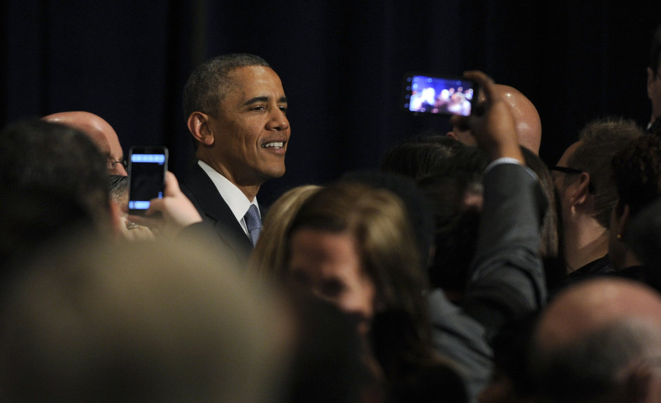 Photo - President Barack Obama greets the crowd after speaking at a Democratic National Committee reception in San Jose, Calif., Thursday, May 8, 2014. Obama is spending three days in California raising money for the Democratic party. (AP Photo/Susan Walsh)