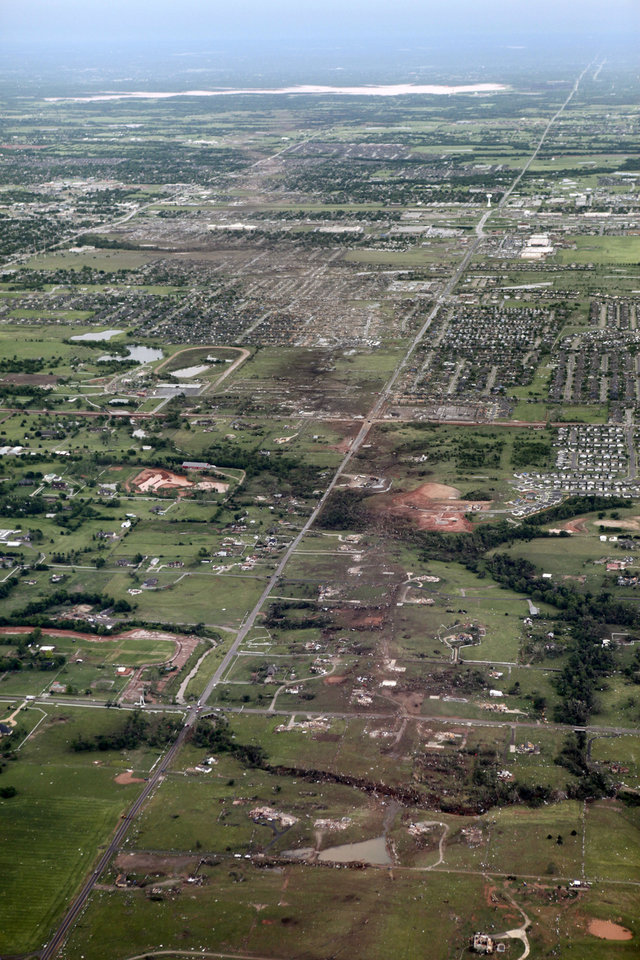 Photo - The path of the May 20th tornado can be seen looking east in Moore, OK, Tuesday, May 21, 2013,  By Paul Hellstern, The Oklahoman