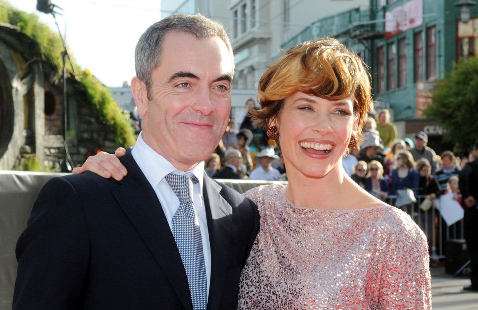 Photo -   Cast members James Nesbitt who plays Bofur, left, and Canadian actress Evangeline Lilly pose on the red carpet at the premiere of