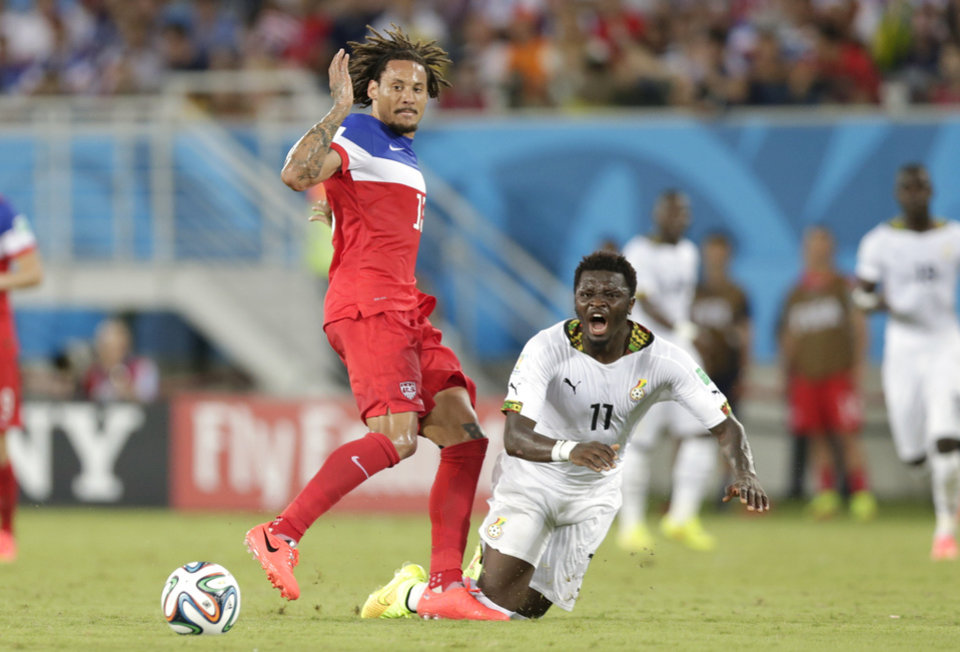 Photo - Ghana's Sulley Muntari, right, is fouled by United States' Jermaine Jones during the group G World Cup soccer match between Ghana and the United States at the Arena das Dunas in Natal, Brazil, Monday, June 16, 2014.  (AP Photo/Dolores Ochoa)