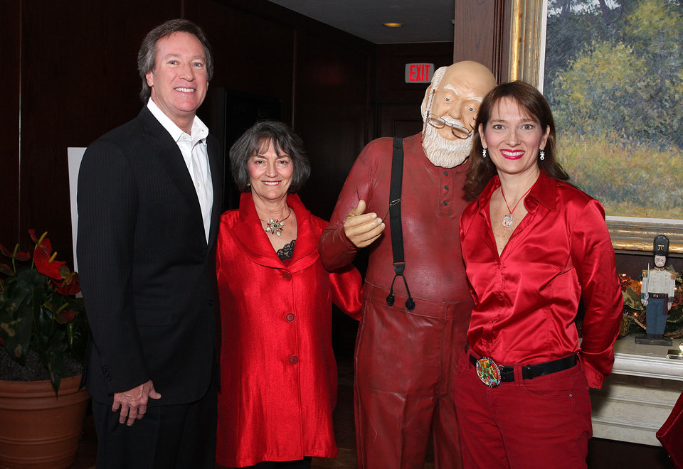 Bill Burgess, Kanela Huff, Santa, Lisa Voegeli.  PHOTO BY DAVID FAYTINGER, FOR THE OKLAHOMAN