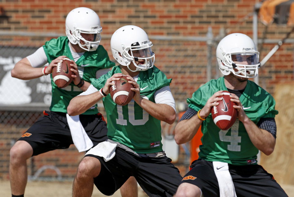 OKLAHOMA STATE UNIVERSITY / OSU / COLLEGE FOOTBALL: Oklahoma State quarterbacks Wes Lunt, left, Clint Chelf, and J.W. Walsh, at right,  take part in an OSU spring football practice in Stillwater, Okla., Wednesday, March 13, 2013. Photo by Bryan Terry, The Oklahoman