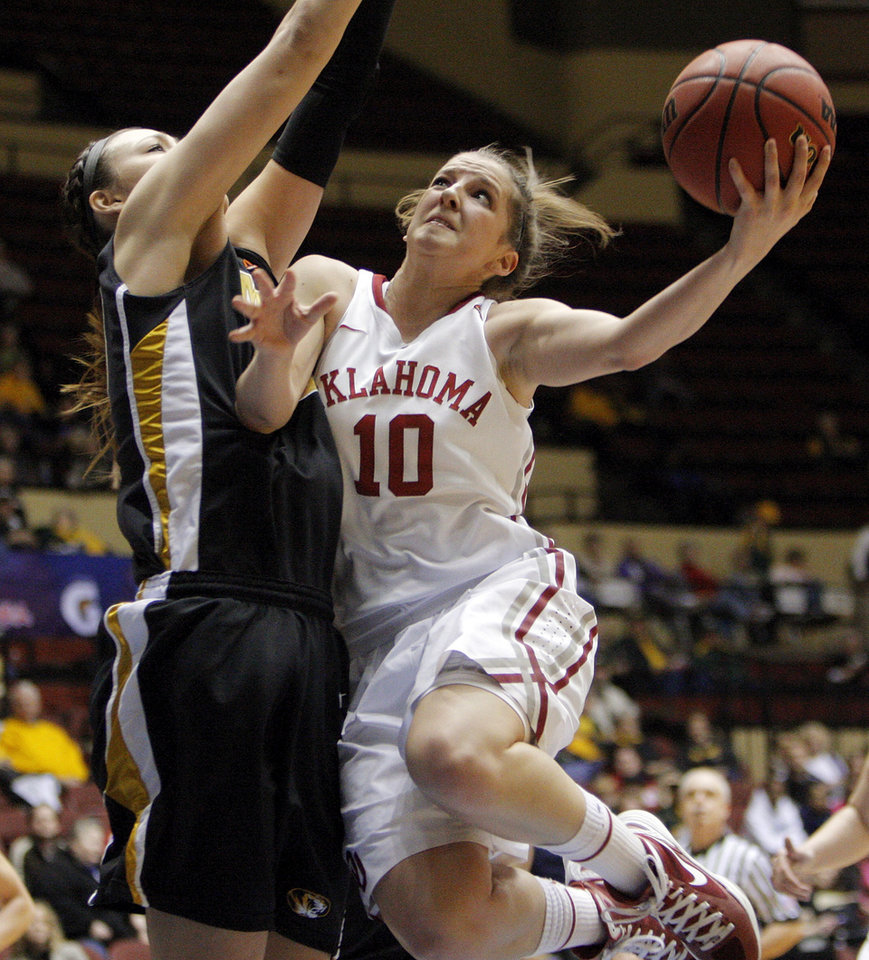 OU's Morgan Hook (10) shoots against Missouri's Christine Flores (50) during the Big 12 tournament women's college basketball game between the University of Oklahoma Sooners and the University of Missouri Tigers at Municipal Auditorium in Kansas City, Mo., Thursday, March 8, 2012. Photo by Nate Billings, The Oklahoman