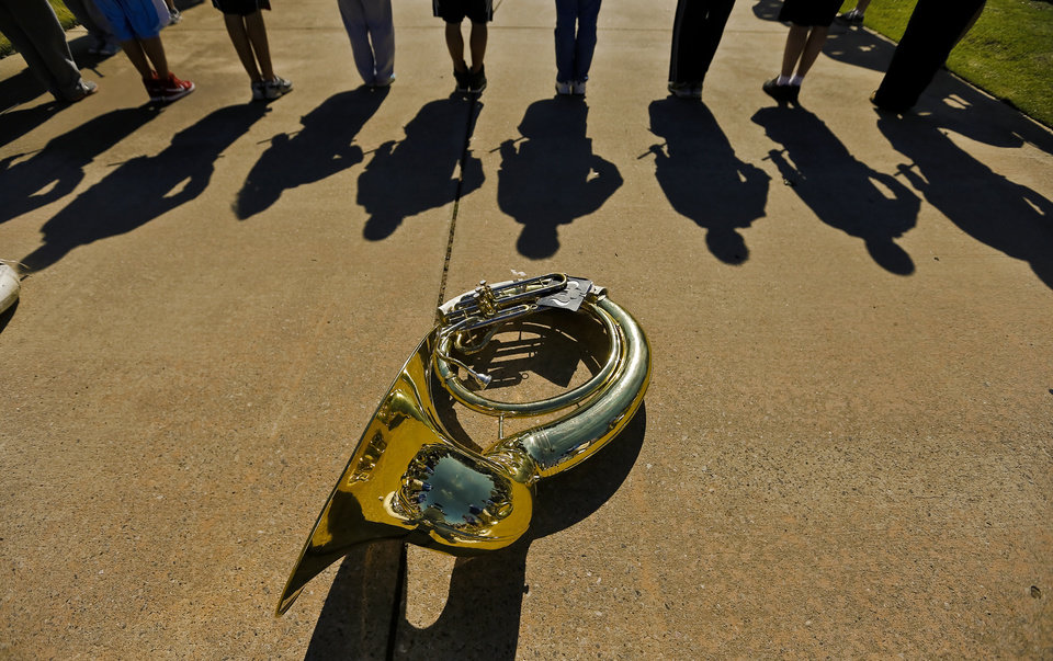 "A tuba sits on the ground as the ""Band of The Fighting Irish,"" along with the spirit squads and mascot put on a special performance for the patients and employees of The Children's Center on Friday, Oct. 26, 2012, in Bethany, Okla. Photo by Chris Landsberger, The Oklahoman"