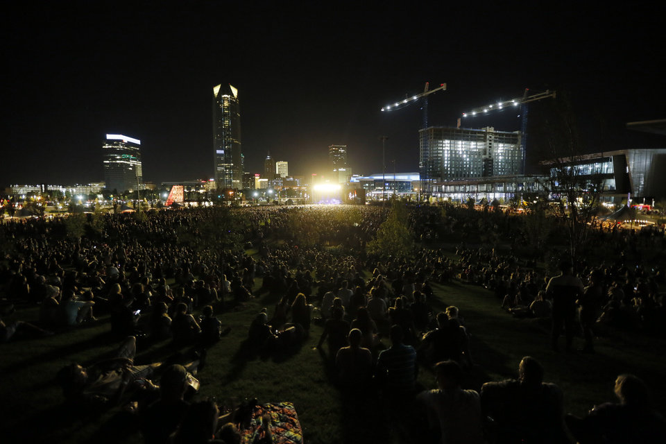 Photo - A view from the hill as Kings of Leon perform during the grand opening of Scissortail Park in Oklahoma City, Friday, Sept. 27, 2019. [Nate Billings/The Oklahoman]