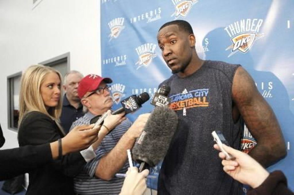 Oklahoma City Thunder's Kendrick Perkins is interviewed by members of the media after practice in Oklahoma City, March 1 , 2011. Photo by Steve Gooch, The Oklahoman