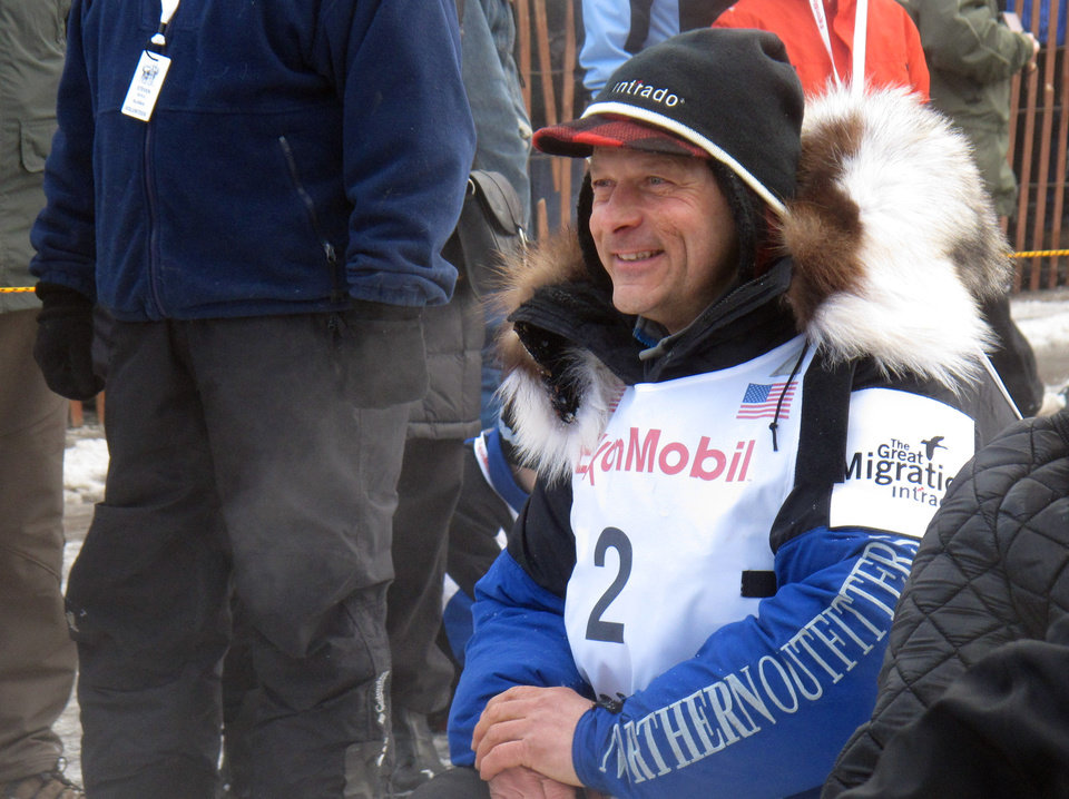 Four-time champion Martin Buser waits for the ceremonial start of the 2013 Iditarod Trail Sled Dog Race in Anchorage, Alaska on Saturday, March 2, 2013. The race, which will take mushers and dog teams about a thousand miles across the Alaska wilderness, starts Sunday, March 3, 2013, in Willow, Alaska. (AP Photo/Mark Thiessen)