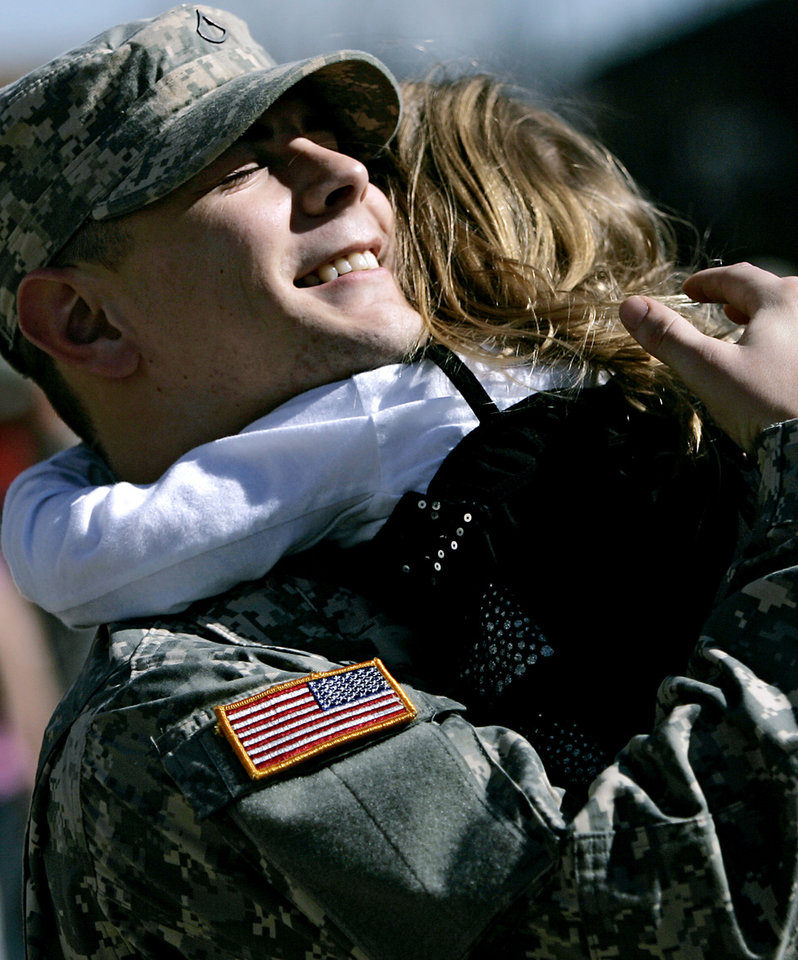 MILITARY DEPLOYMENT / OKLAHOMA CITY ARENA: Cody Black, of Oklahoma City, hugs his daughter Keagan Black, 3, as he meets his family outside the OKC Arena following a deployment ceremony for members of the 45th Infantry Brigade Combat Team at The OKC Arena in Oklahoma City on Wednesday, Feb. 16, 2011. Photo by John Clanton, The Oklahoman