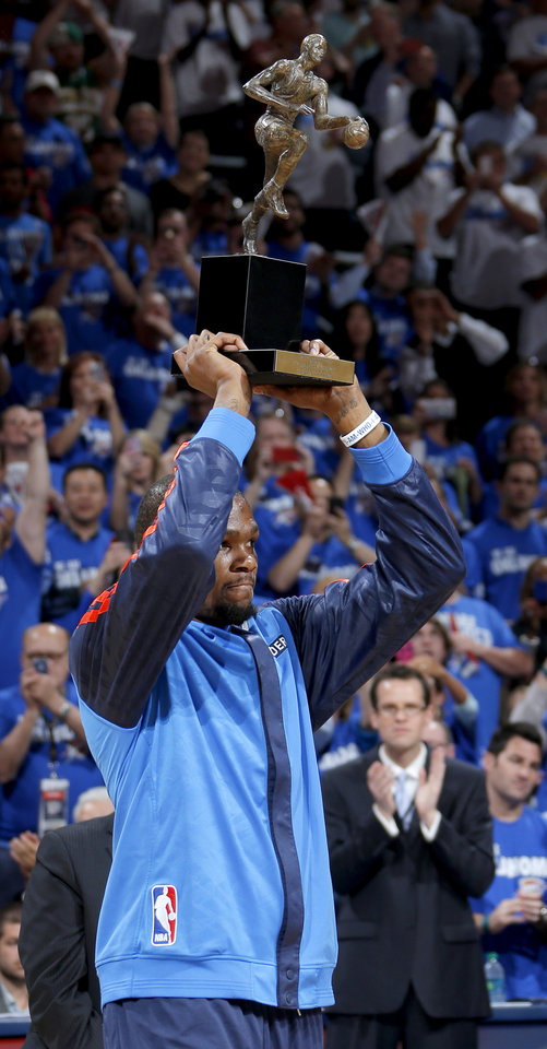 Photo - Oklahoma City's Kevin Durant holds up the MVP trophy before Game 2 of the Western Conference semifinals in the NBA playoffs between the Oklahoma City Thunder and the Los Angeles Clippers at Chesapeake Energy Arena in Oklahoma City, Wednesday, May 7, 2014. Photo by Bryan Terry, The Oklahoman