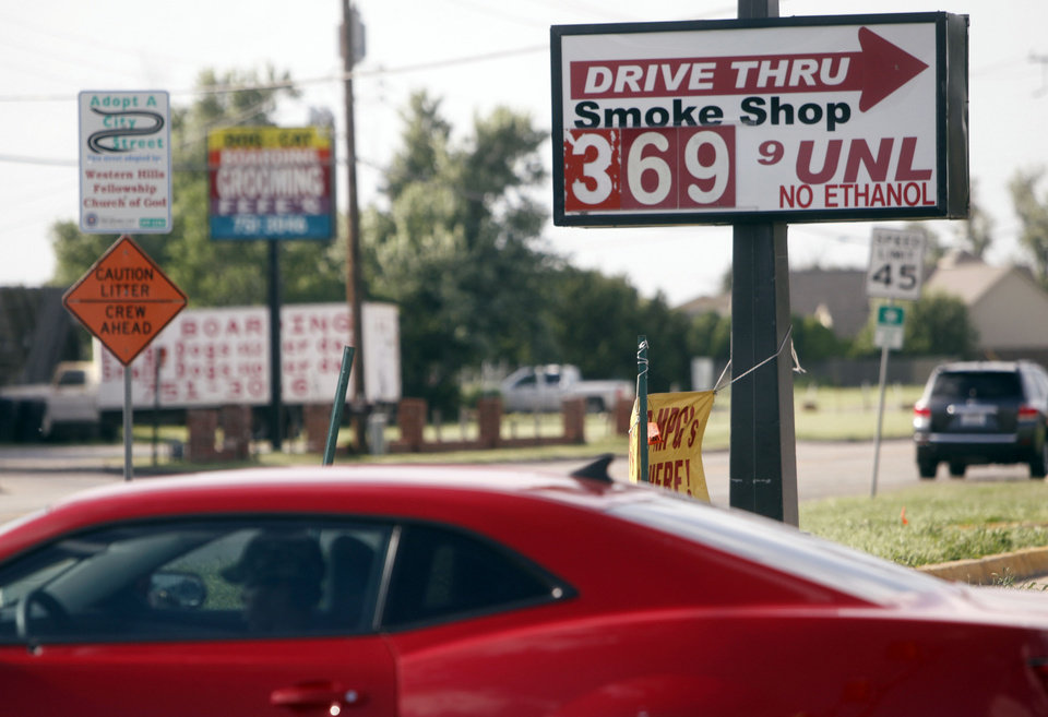 Photo -  Gas prices at a gas station in Oklahoma City reach $3.69 on June 17, 2014. Photo by K.T. King/The Oklahoman   KT King -  The Oklahoman