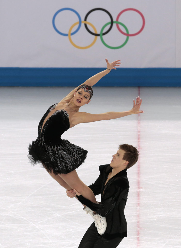 Photo - Elena Ilinykh and Nikita Katsalapov of Russia compete in the ice dance free dance figure skating finals at the Iceberg Skating Palace during the 2014 Winter Olympics, Monday, Feb. 17, 2014, in Sochi, Russia. (AP Photo/Ivan Sekretarev)