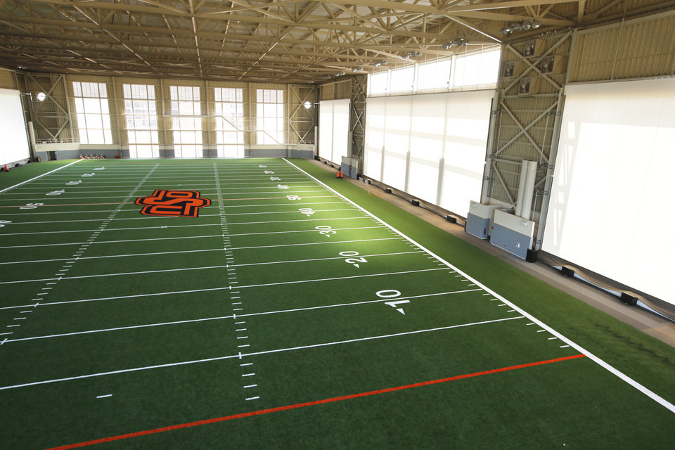 Photo - Oklahoma State University (OSU) unveils its new Sherman E. Smith Training Center indoor football practice facility on Friday, July 12, 2013 in Stillwater, Okla.  Photo by Steve Sisney, The Oklahoman