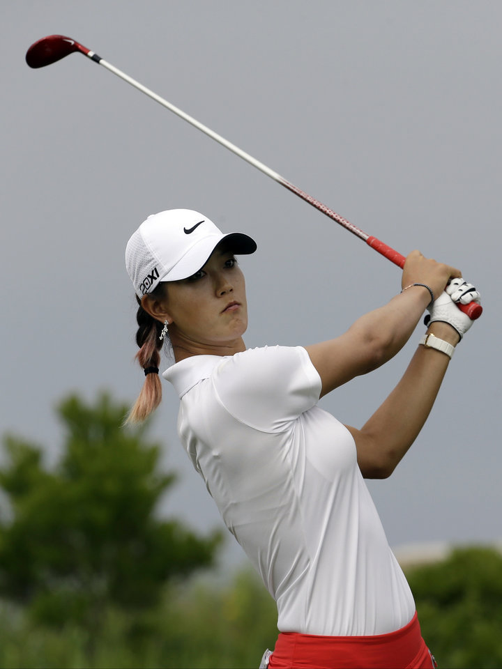 Photo - Michelle Wie tees off on the 16th hole during the first round of the U.S. Women's Open golf tournament at the Sebonack Golf Club Thursday, June 27, 2013, in Southampton, N.Y.  (AP Photo/Frank Franklin II)
