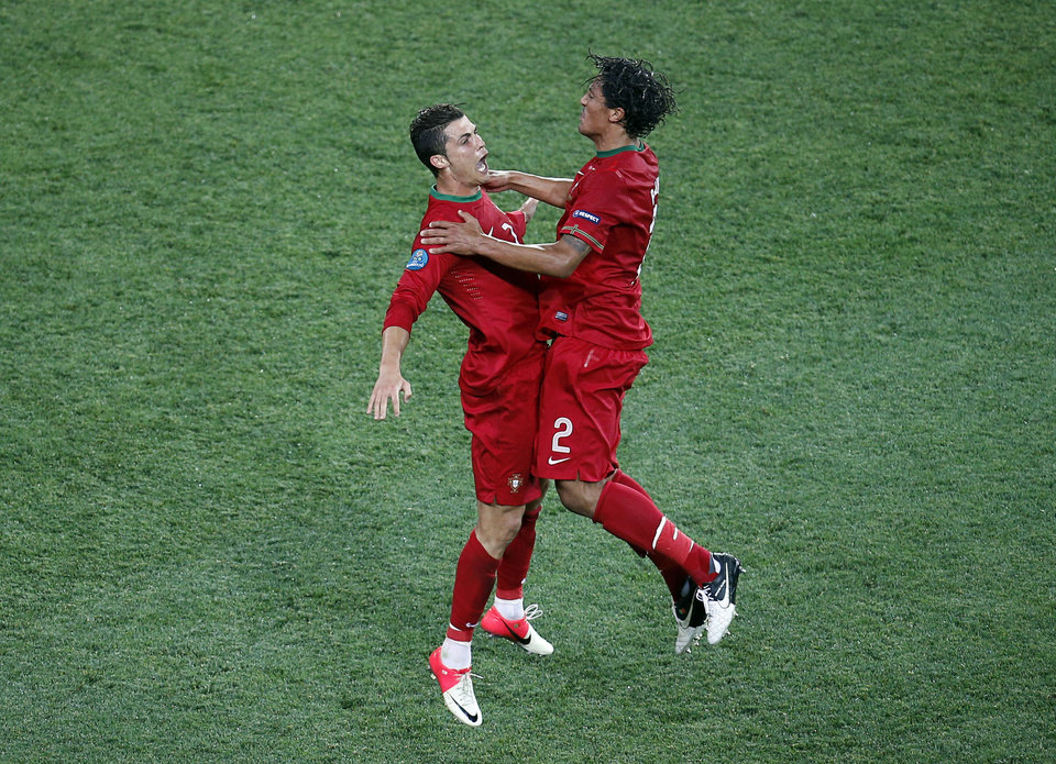 Portugal's Cristiano Ronaldo, left, and Bruno Alves celebrate the second goal during the Euro 2012 soccer championship Group B match between Portugal and the Netherlands in Kharkiv, Ukraine, Sunday, June 17, 2012. (AP Photo/Vadim Ghirda)
