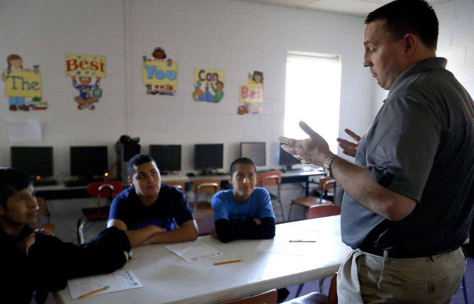 Photo - From left to right Douglas Fry, Curtis Smith and Daniel Fry listen to Principal Dax Trent at Ryal Public School, Wednesday, Feb. 13, 2013. Photo by Sarah Phipps, The Oklahoman