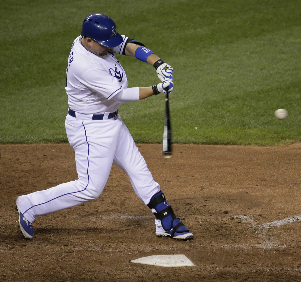 Kansas City Royals' Billy Butler hits a two-run home run during the eighth inning of a baseball game against the Cleveland Indians, Friday, July 25, 2014, in Kansas City, Mo. (AP Photo/Charlie Riedel)