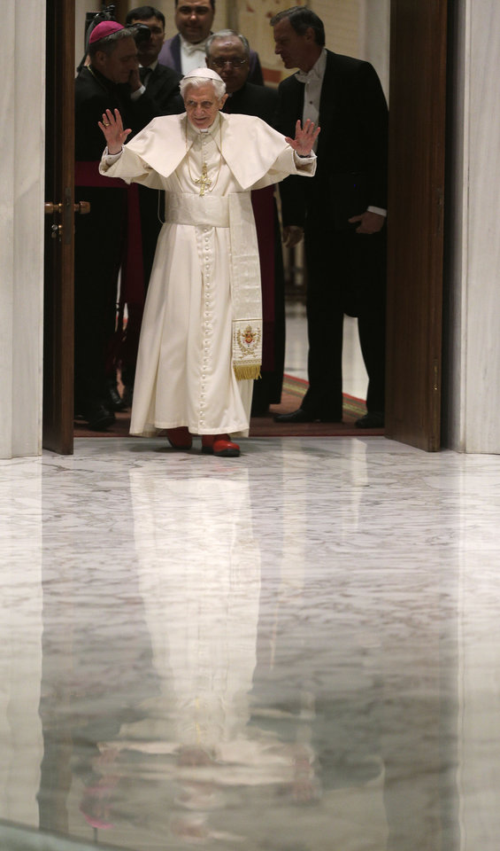 Photo - Pope Benedict XVI arrives for his weekly general audience at the Paul VI Hall at the Vatican, Wednesday Feb. 13, 2013. Thousands of people flooded the Vatican's main audience hall Wednesday for Pope Benedict XVI's first public appearance since his bombshell resignation announcement, taking advantage of his second-to-last public audience before retiring at the end of the month. (AP Photo/Alessandra Tarantino)