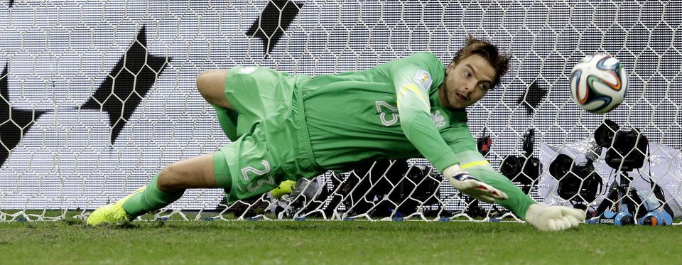 Photo - Netherlands' goalkeeper Tim Krul saves a penalty during penalty kicks of the World Cup quarterfinal soccer match between the Netherlands and Costa Rica at the Arena Fonte Nova in Salvador, Brazil, Saturday, July 5, 2014. (AP Photo/Hassan Ammar)