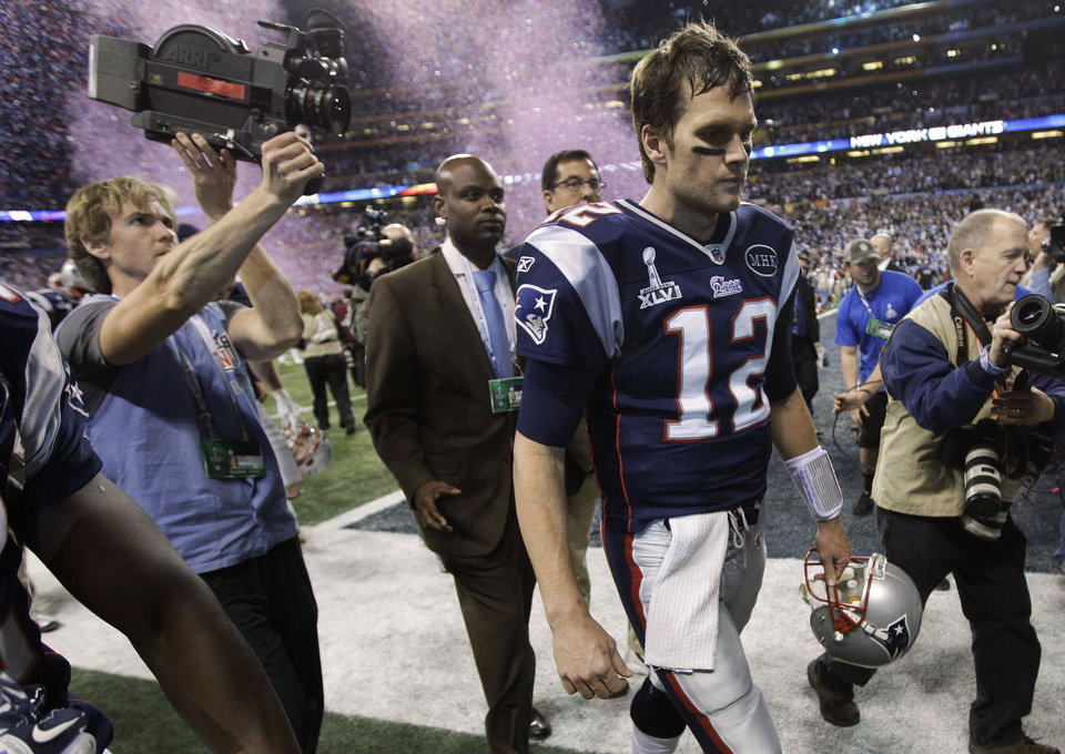 New England Patriots quarterback Tom Brady walks off the field after the Patriots\' 21-17 loss to the New York Giants in the NFL Super Bowl XLVI football game, Sunday, Feb. 5, 2012, in Indianapolis. (AP Photo/Paul Sancya) ORG XMIT: SB486