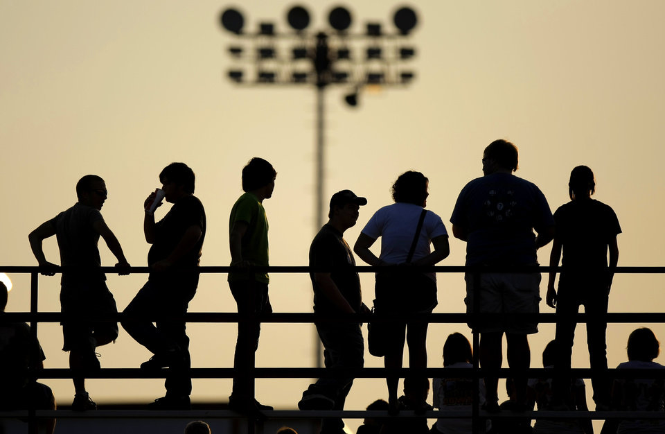 Photo -  High school football fans wait for the start of Del City's football game against Midwest City in Del City, Okla., Friday, September 2, 2011. Photo by Bryan Terry, The Oklahoman ORG XMIT: KOD