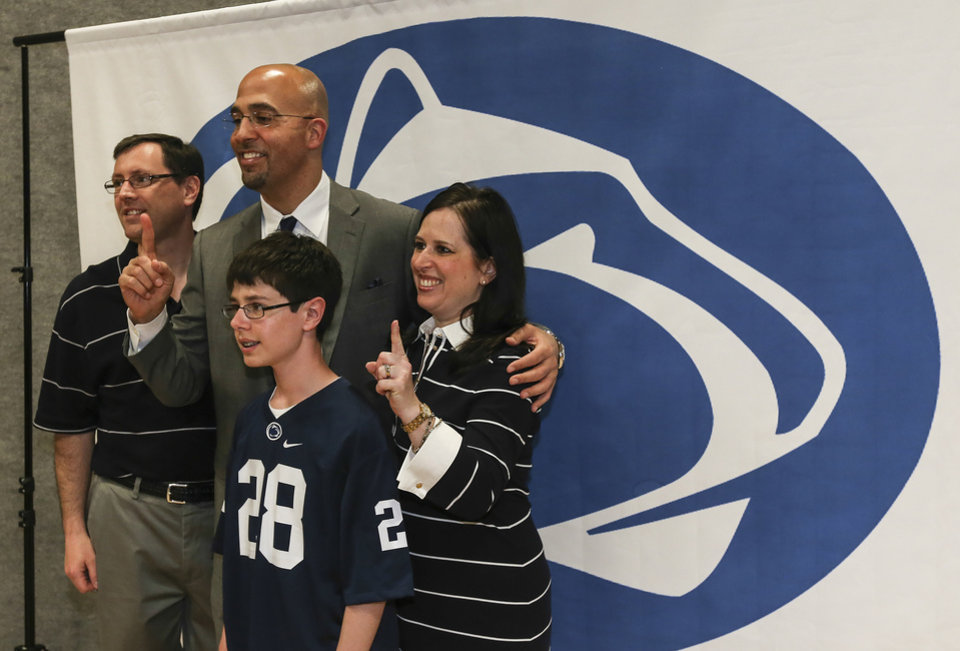 Photo - Penn State football coach James Franklin, center, poses for a photo with the Ridyard family, from left, Rob, Connor and Lori, from Spring City, Pa., at Valley Forge Casino on Tuesday, May 13, 2014, in Valley Forge, Pa. Rob and Lori Ridyard are Penn State alumni. (AP Photo/The Philadelphia Daily News, Steven M. Falk) THE EVENING BULLETIN OUT  TV OUT  MAGS OUT  NO SALES