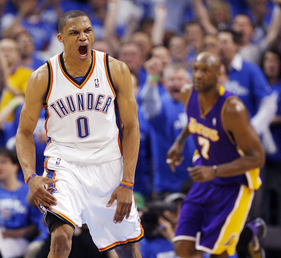 GAME THREE / L.A. LAKERS / REACTION: Oklahoma City's Russell Westbrook (0) reacts after dunking the ball in the fourth quarter in front of Lamar Odom (7) of L.A. during the NBA basketball game between the Los Angeles Lakers and the Oklahoma City Thunder in the first round of the NBA playoffs at the Ford Center in Oklahoma City, Thursday, April 22, 2010. Oklahoma City won, 101-96. Photo by Nate Billings, The Oklahoman ORG XMIT: KOD