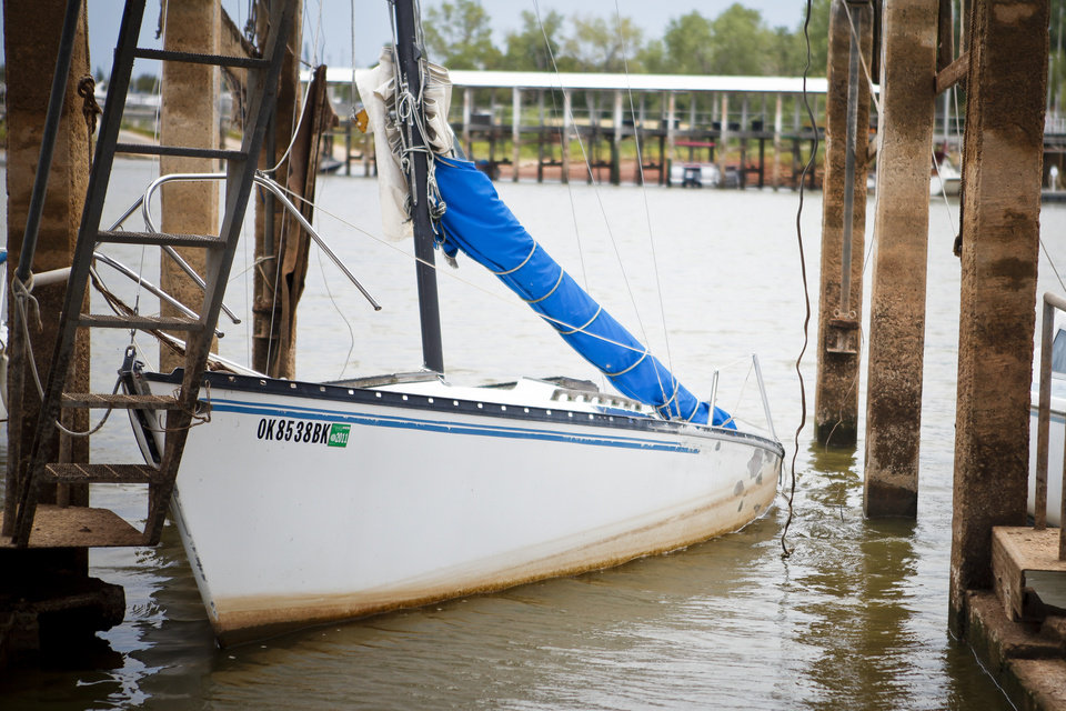 A partially sunken sailboat at Lake Hefner on Thursday, Aug. 11, 2011. Lakes around Oklahoma are experiencing extremely low levels due to the recent droughts and high temperatures. Photo by Zach Gray, The Oklahoman