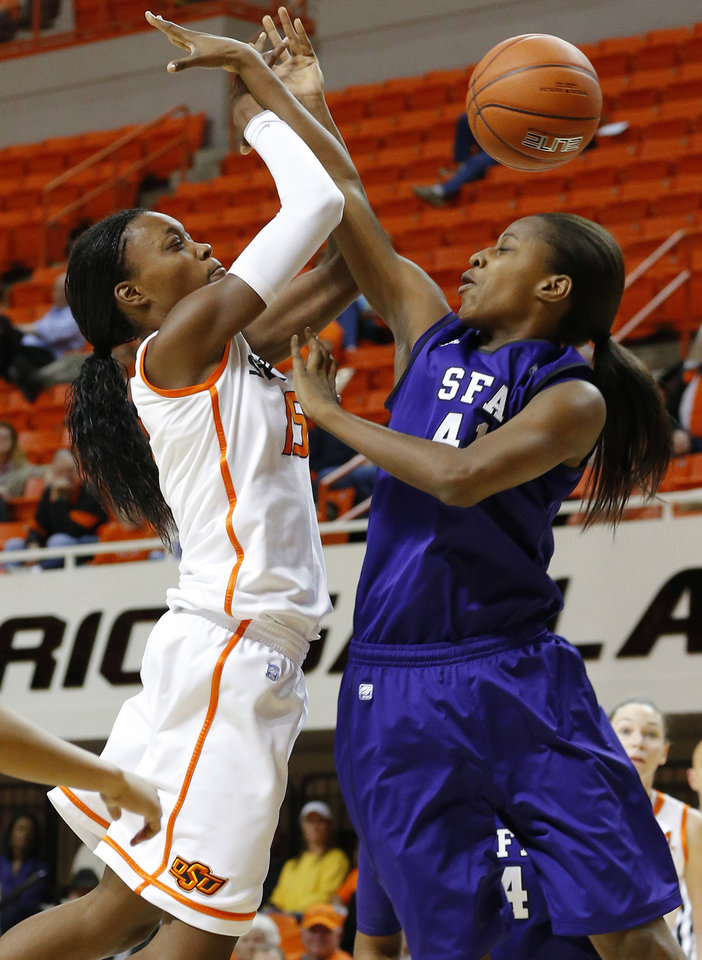 Photo - Oklahoma State's Toni Young (15) runs into Stephen F. Austin's Wykeia Sanders (41) during a women's college basketball game between Oklahoma State University and Stephen F. Austin at Gallagher-Iba Arena in Stillwater, Okla., Thursday, Dec. 6, 2012.  Photo by Bryan Terry, The Oklahoman