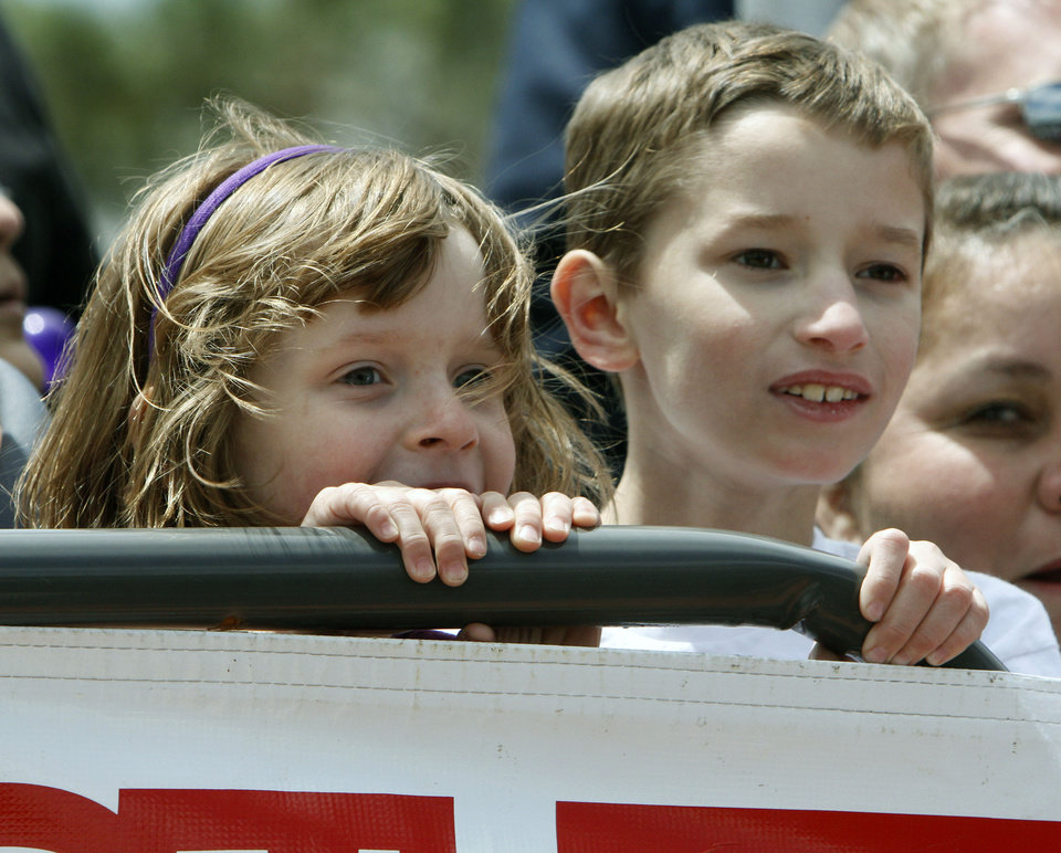 Five year old Emily Plemons and her eight year old brother Matthew watch as an enormous burger is flipped over during the Fabulous Burger Day Festival in El Reno, OK, Saturday, May 4, 2013,  By Paul Hellstern, The Oklahoman