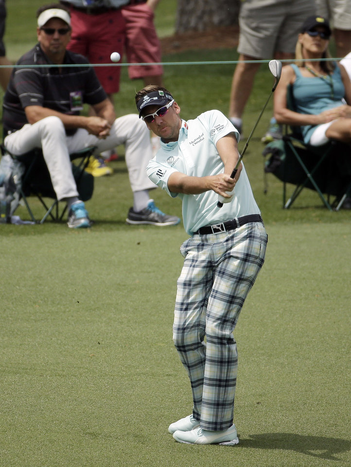 Photo - Ian Poulter, of England, chips to the second green during the second round of the Masters golf tournament Friday, April 11, 2014, in Augusta, Ga. (AP Photo/Chris Carlson)