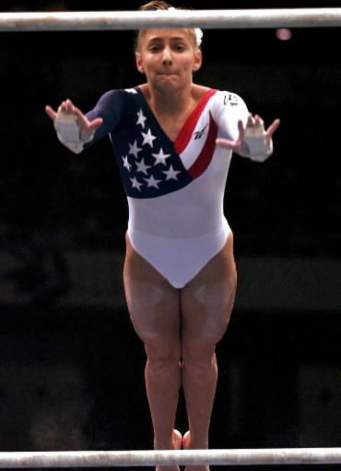 Photo -  Shannon  Miller of United States performs her routine on the uneven bars during the women's team gymnastics competition at the 1996 Centennial Summer  Olympics Games in Atlanta on Tuesday, July 23, 1996. (AP Photo/Amy Sancetta)