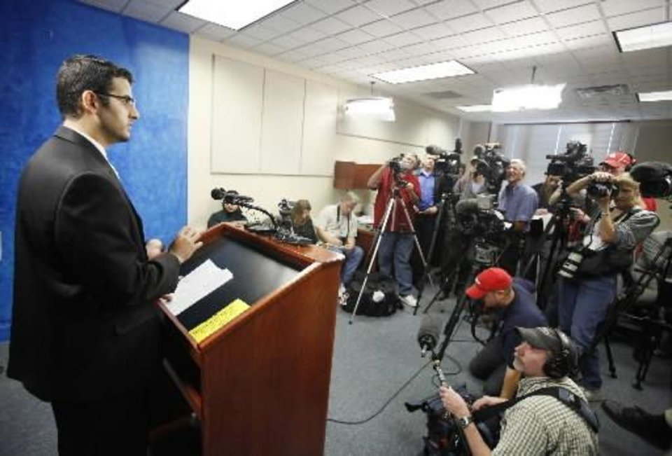 Photo - Muneer Awad, executive director of CAIR-OKC speaks during a press conference after filing a lawsuit challenging the constitutionality of State Question 755, the  Sharia  Law at the state Capitol in Oklahoma City, Nov. 4. Photo by Steve Gooch