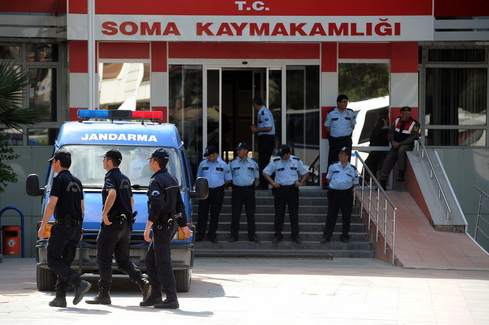 Photo - Police officers at the entrance of sub-governor office of coal miners' town of Soma, Turkey, Sunday, May 18, 2014. Eighteen people, including mining company executives, have been detained as Turkish officials investigate the mining disaster that killed 301 people, a domestic news agency reported Sunday.(AP Photo/Emre Tazegul)