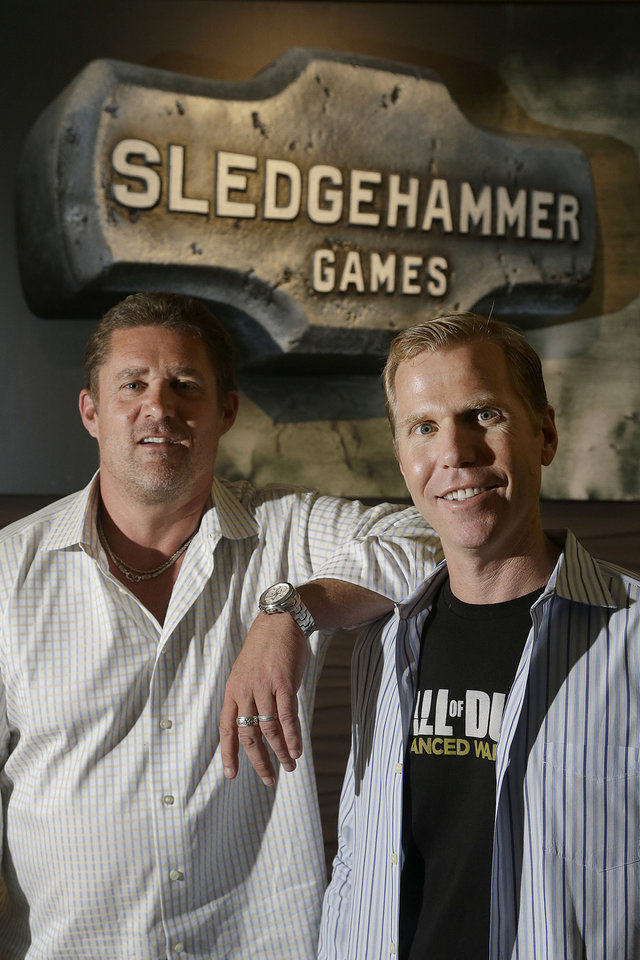 Photo - This July 31, 2014 shows Glen Schofield, left, and Michael Condrey, co-founders of Sledgehammer Games pose at their office in Foster City, Calif. Their latest