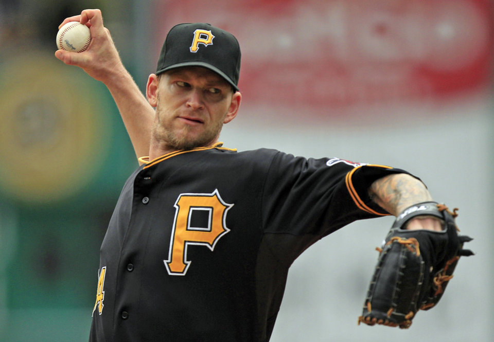 Photo -   Pittsburgh Pirates starter A.J. Burnett delivers a pitch during the first inning of a baseball game against the Atlanta Braves in Pittsburgh, Wednesday, Oct. 3, 2012. (AP Photo/Gene J. Puskar)