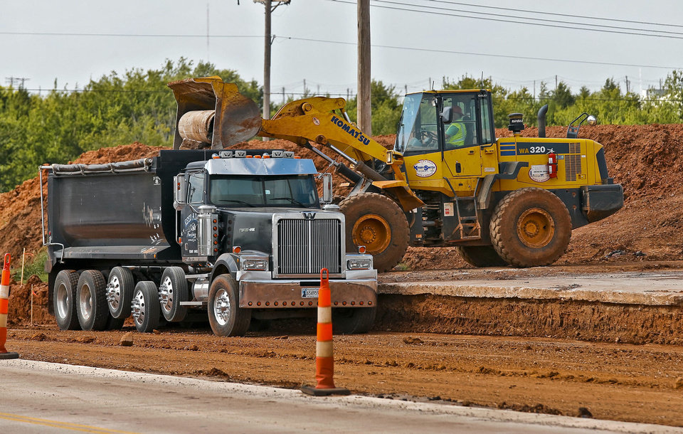 Road crews continue work on a road expansion project near NW 164th and Penn Ave. on Wednesday, Oct. 2, 2013 in Edmond, Okla.   Photo by Chris Landsberger, The Oklahoman