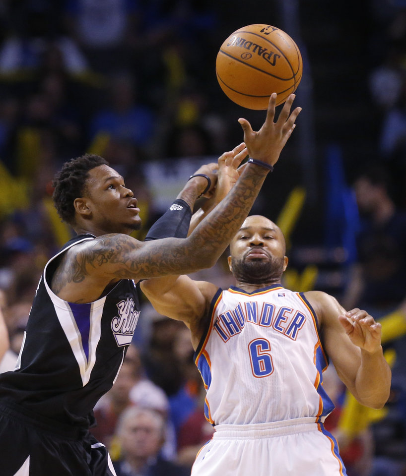 Photo - Sacramento Kings guard Ben McLemore (16) reaches for the ball in front of Oklahoma City Thunder guard Derek Fisher (6) in the fourth quarter of an NBA basketball game in Oklahoma City, Sunday, Jan. 19, 2014. Oklahoma City won 108-93. (AP Photo/Sue Ogrocki)