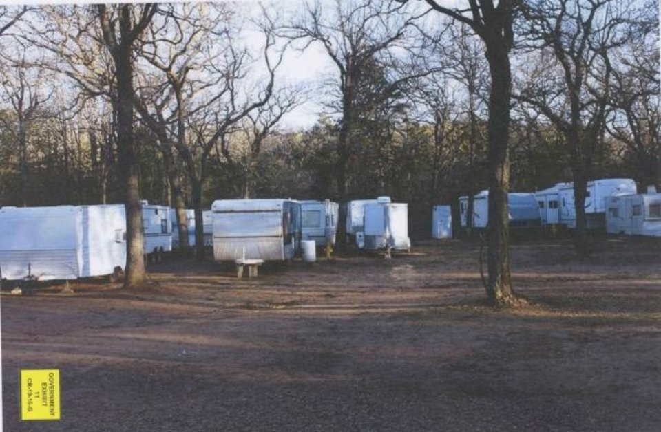Photo -  Investigators counted more than 40 converted trailers at a cockfighting site near Anadarko during a 2016 search. Handlers used the trailers to hold their birds while they waited to fight and to tie knives or gaffs to the birds when it was time. [Photo provided]