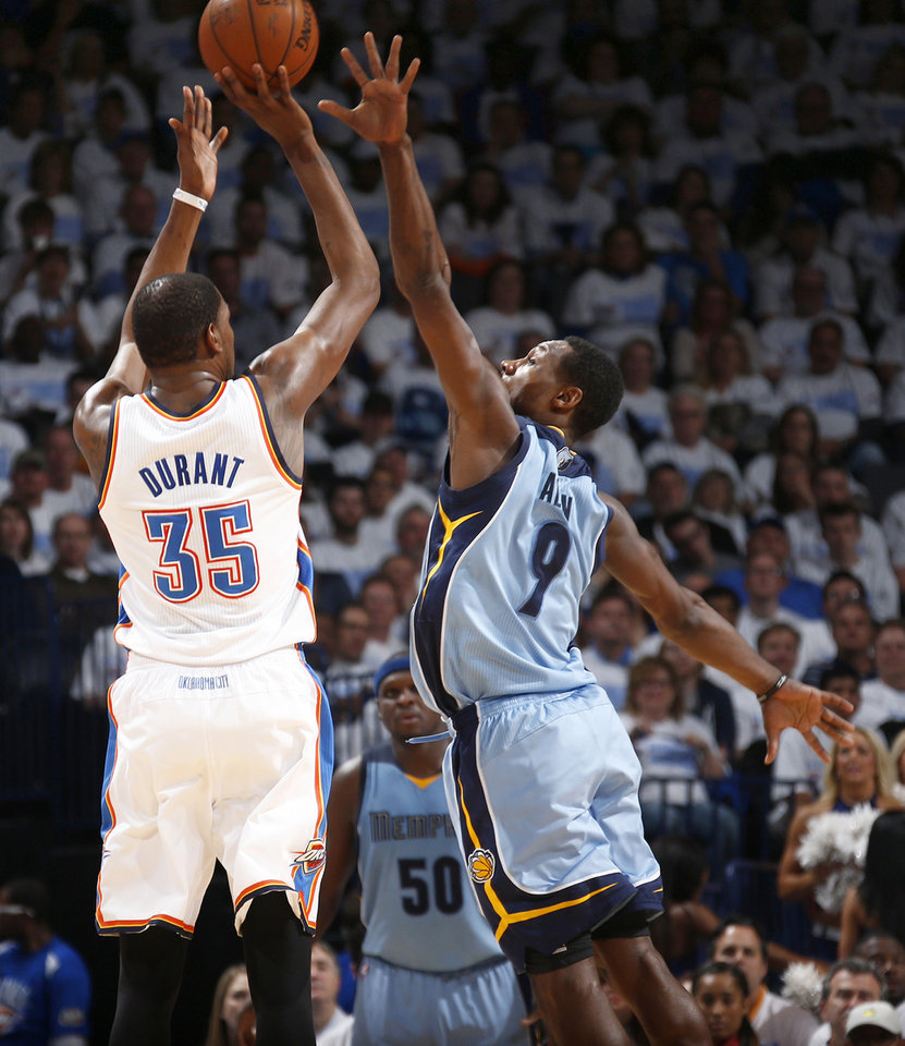 Photo - Oklahoma City's Kevin Durant (35) shoots over Memphis' Tony Allen (9) during Game 5 in the first round of the NBA playoffs between the Oklahoma City Thunder and the Memphis Grizzlies at Chesapeake Energy Arena in Oklahoma City, Tuesday, April 29, 2014. Photo by Sarah Phipps, The Oklahoman
