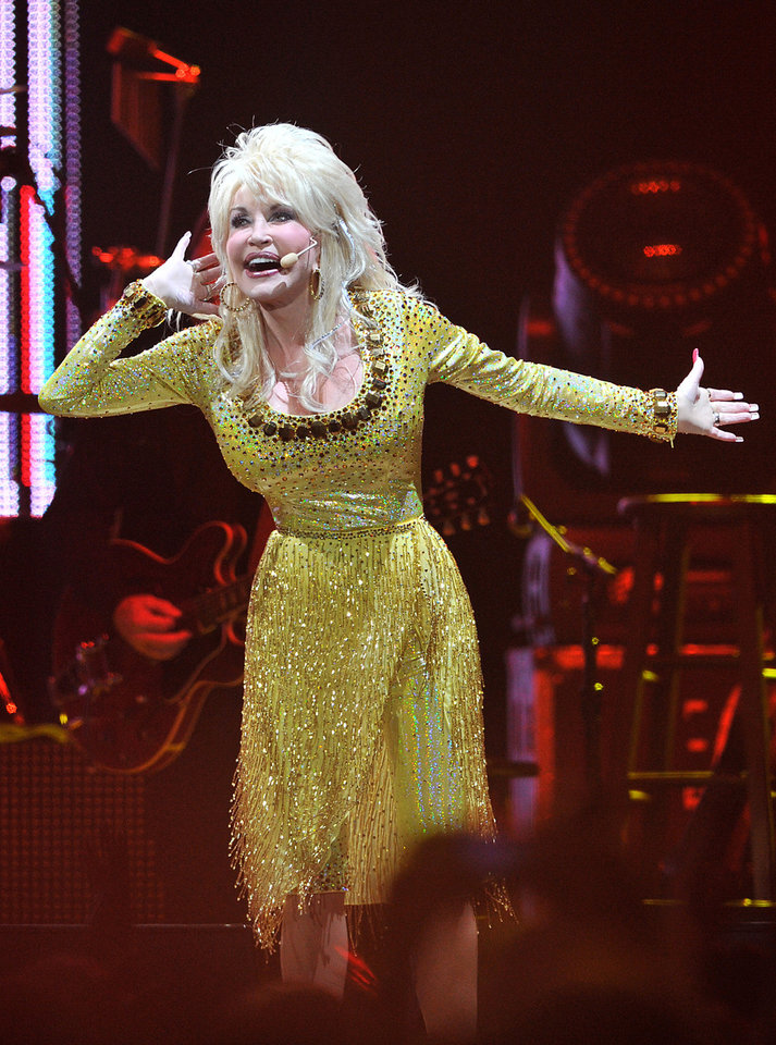 Photo - US singer Dolly Parton performs in concert at the O2 Arena in London on Wednesday, Sept. 7, 2011.  (AP Photo/Mark Allan) ORG XMIT: LMA101