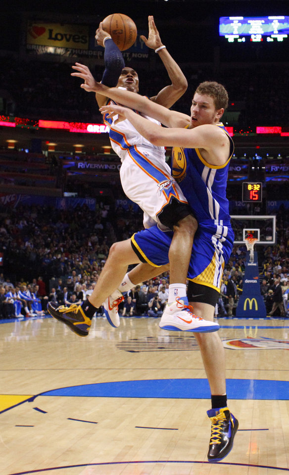 Photo - Oklahoma City's Russell Westbrook (0) runs into Golden State's David Lee (10) during the NBA basketball game between the Oklahoma City Thunder and the Golden State Warriors at the Oklahoma City Arena, Tuesday, March 29, 2011. Photo by Bryan Terry, The Oklahoman