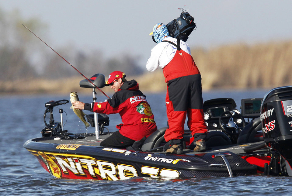 Kevin Van Dam pulls in another fish in the 2011 Bassmaster Classic. Van Dam will be trying to win his fifth Bassmaster Classic title next month on Oklahoma\'s Grand Lake. AP ARCHIVE PHOTO