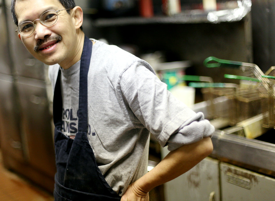 Photo - Max Chow poses in the kitchen at Chow's Chinese Restaurant in Oklahoma City on Monday, Feb. 8, 2010. Photo by John Clanton, The Oklahoman ORG XMIT: KOD