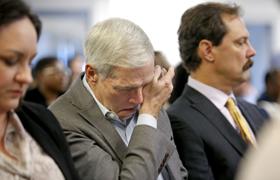 Photo - Mark Burget reacts after the Pardon and Parole Board read the names of 527 Oklahoma inmates recommend for commutation at the Kate Barnard Correctional Center in Oklahoma City, Friday, Nov. 1, 2019. [Sarah Phipps/The Oklahoman]